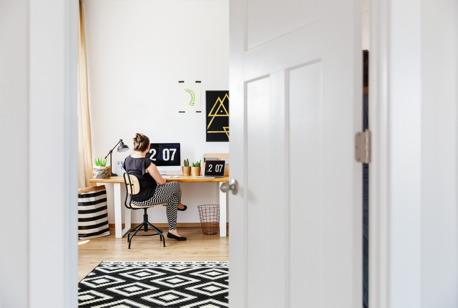 Scandinavian style home office with a three panel craftsman style interior door