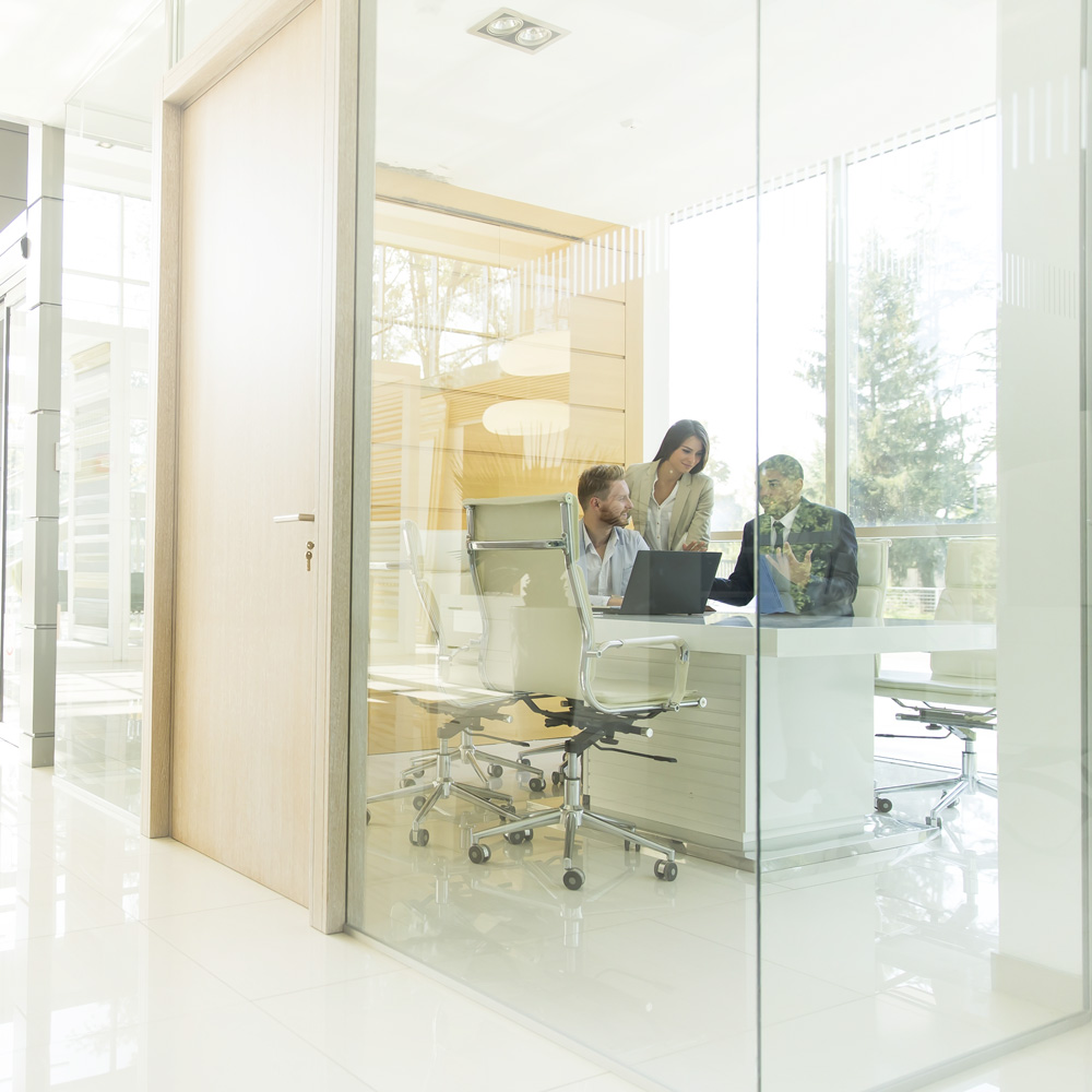 Commercial Door for an office with 3 people in a meeting