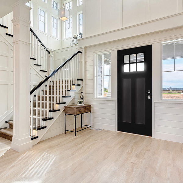 Craftsman style home entryway with a Heritage Series 2 panel black door