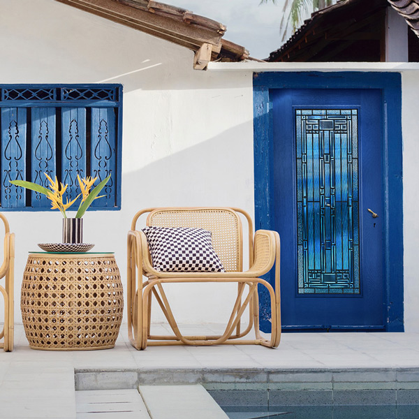 Traditional style home back porch with a full lite blue door