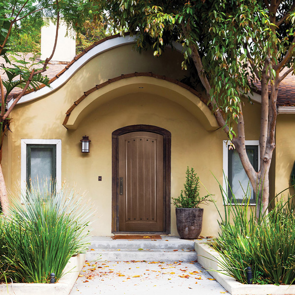 Front of home with an arch top plank panel Barrington door