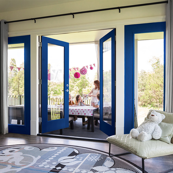 Traditional style den view of back patio with full lite blue Vista Grande double doors