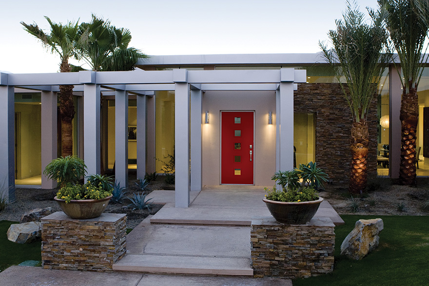 mid century modern home with red front door