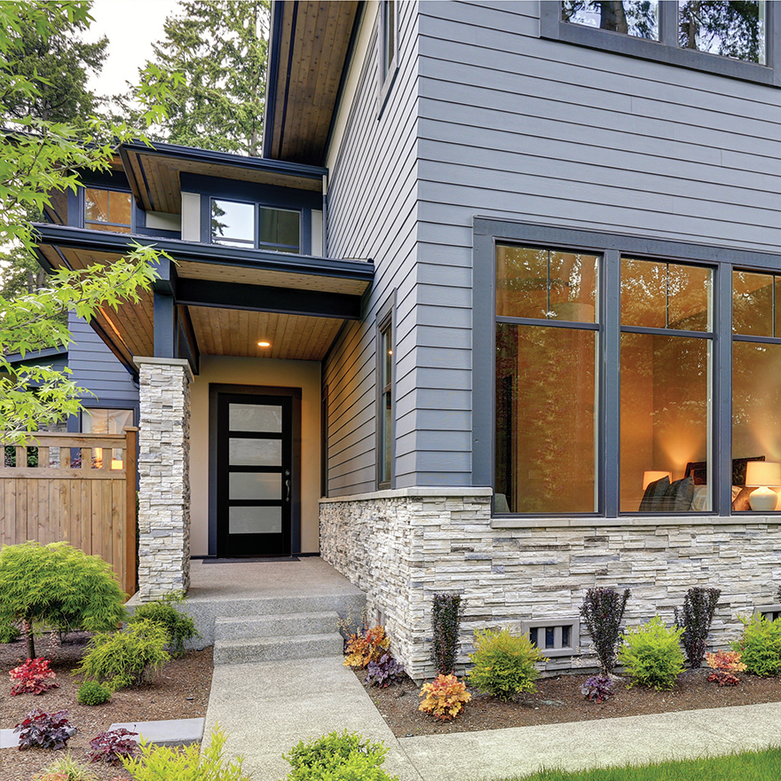 Modern style home with a black 4 equal lite front door with modern SDL bars